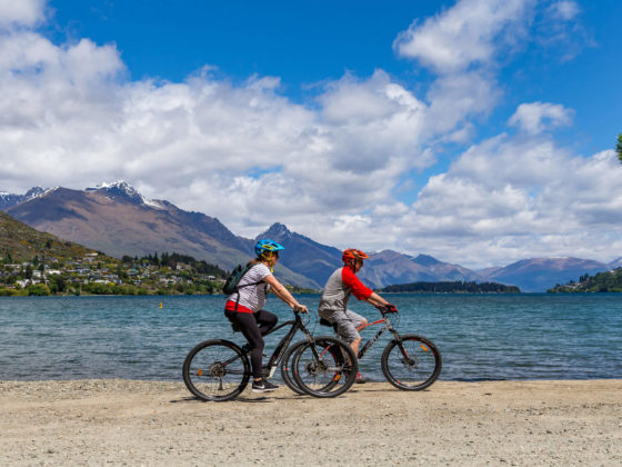 enjoying biking along the lake shore by Queenstown
